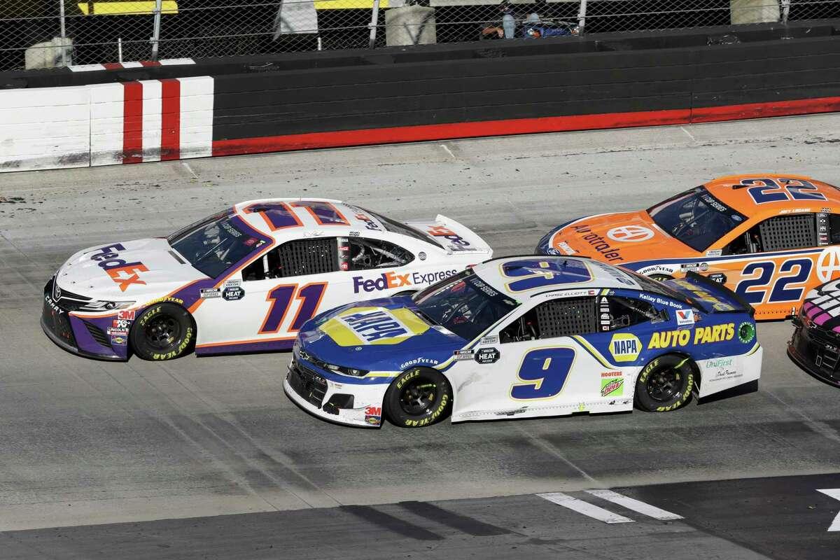 Denny Hamlin (11) drives followed by Chase Elliott (9) and Joey Logano (22) during a NASCAR Cup Series auto race at Bristol Motor Speedway Sunday, May 31, 2020, in Bristol, Tenn. (AP Photo/Mark Humphrey)