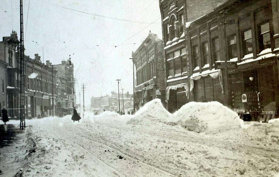This wintry 1890 photograph shows the view looking west on River Street from Poplar Street.
