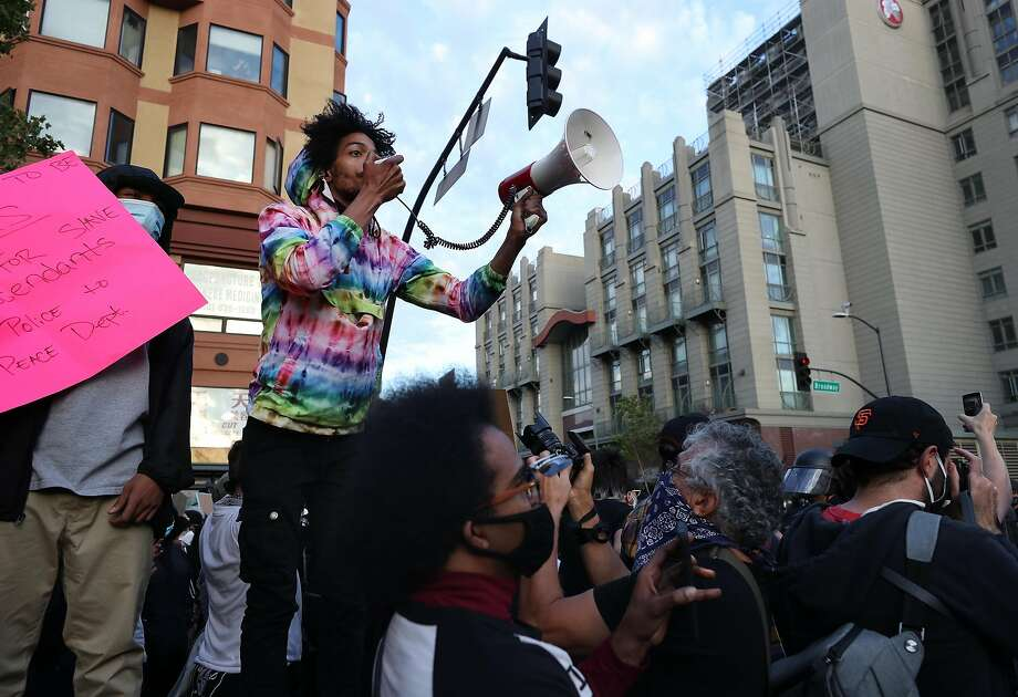 OAKLAND, CALIFORNIA - MAY 29: People participate in a protest sparked by the death of George Floyd while in police custody on May 29, 2020 in Oakland, California. Earlier today, former Minneapolis police officer Derek Chauvin was taken into custody for Floyd's death. Chauvin has been accused of kneeling on Floyd's neck as he pleaded with him about not being able to breathe. Floyd was pronounced dead a short while later. Chauvin and 3 other officers, who were involved in the arrest, were fired from the police department after a video of the arrest was circulated. (Photo by Justin Sullivan/Getty Images) Photo: Justin Sullivan / Getty Images