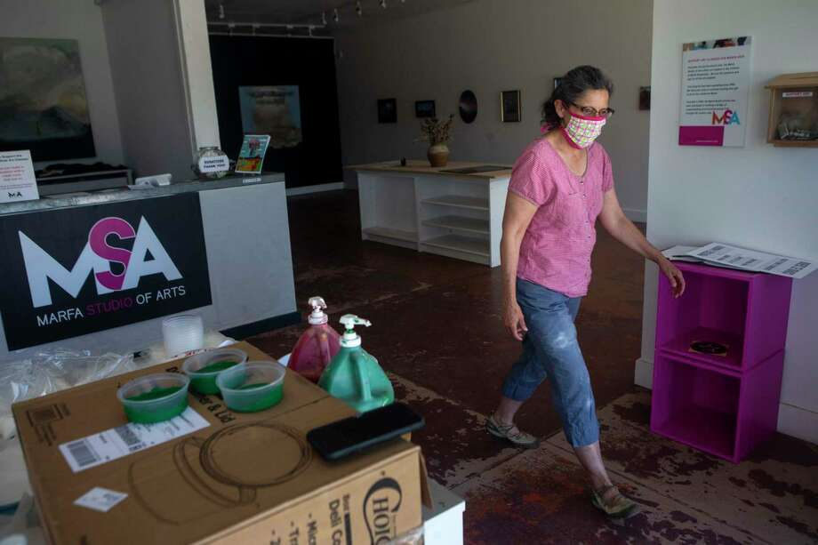 Annette Mendoza of the Marfa Studio of Arts walks around the temporarily closed studio as she prepares take home art kits for students to be distributed the next day in Marfa, Texas, on May 27, 2020. Photo: Josie Norris, The San Antonio Express-News / Staff Photographer / **MANDATORY CREDIT FOR PHOTOG AND SAN ANTONIO EXPRESS-NEWS/NO SALES/MAGS OUT/TV