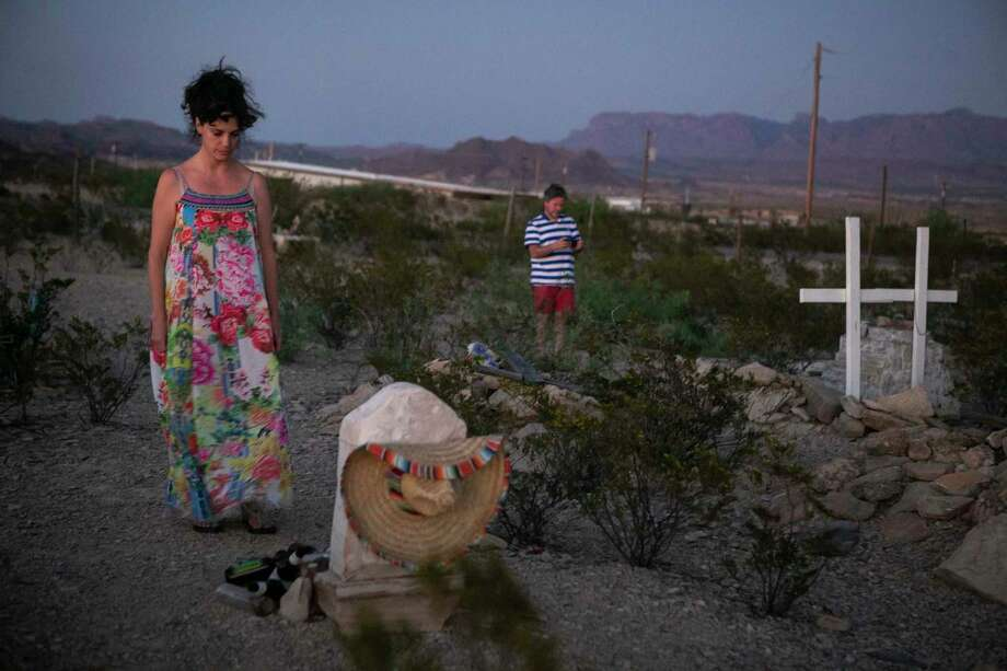 Amy and Christopher Skinner of New Orleans visit the graveyard in Terlingua, their first road trip since the start of the pandemic. Photo: Josie Norris / Staff Photographer / **MANDATORY CREDIT FOR PHOTOG AND SAN ANTONIO EXPRESS-NEWS/NO SALES/MAGS OUT/TV