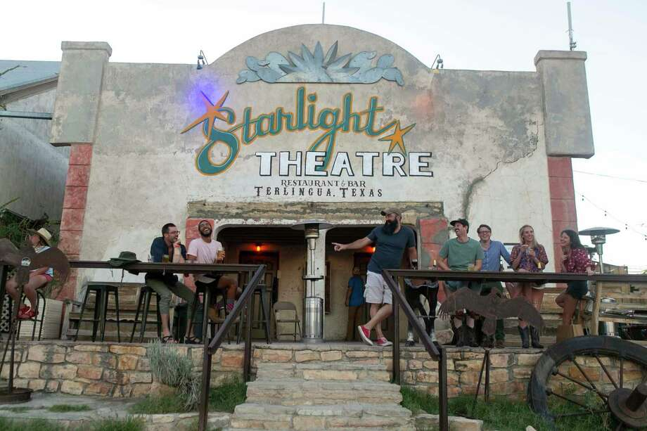 Visitors laugh and talk together outside the Starlight Theatre in Terlingua's ghost town last week. Photo: Josie Norris / Staff Photographer / **MANDATORY CREDIT FOR PHOTOG AND SAN ANTONIO EXPRESS-NEWS/NO SALES/MAGS OUT/TV