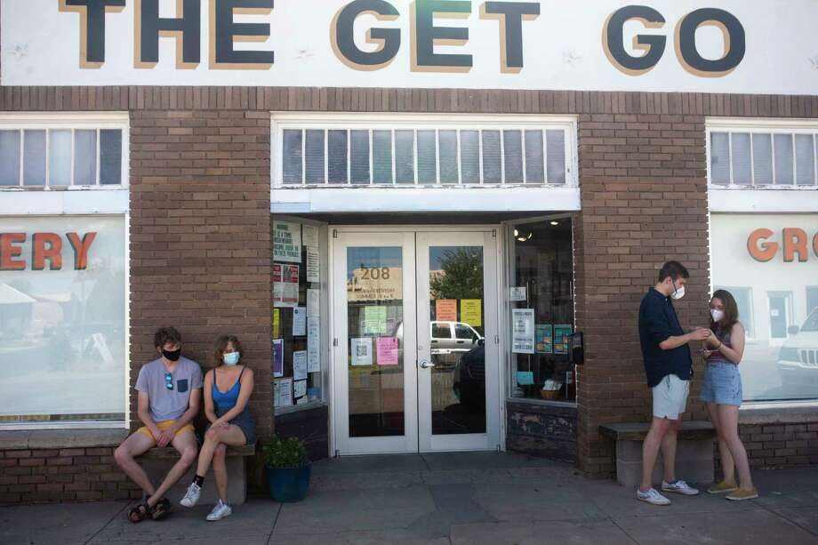 From left, Connor Linguist of Waxahatchee, Kristina Reinis of Austin, Joe Shortell of Dallas, and Carlotta De Bellis of Italy gather outside The Get Go grocery store in Marfa, Texas, as they visit Marfa as part of a post-graduate road trip following their graduations from Trinity University on May 27, 2020. Photo: Josie Norris, The San Antonio Express-News / Staff Photographer / **MANDATORY CREDIT FOR PHOTOG AND SAN ANTONIO EXPRESS-NEWS/NO SALES/MAGS OUT/TV