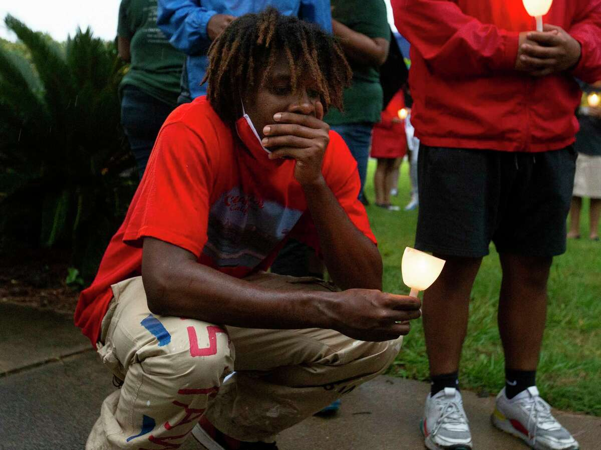 Timothy Freeny, of Richmond, takes a moment to reflect himself after a vigil for George Floyd, who died in Minneapolis Police Department custody earlier this week, Sunday, May 31, 2020, at Metropolitan Community Church in Houston. The vigil held an eight-minute-and-46-seconds moment of silence, the time that white MPD officer, Derek Chauvin, kept his knee on Floyd's neck, to remember Floyd.