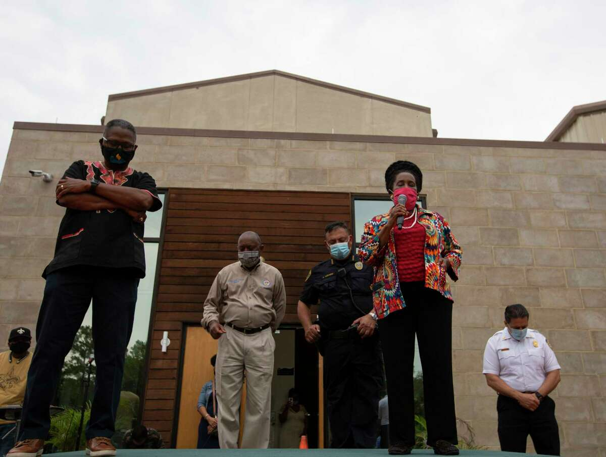 U.S. Rep. Sheila Jackson Lee leads a prayer with Pastor and Dr. Paul Cannings, from left, Mayor Sylvester Turner, Houston Police Chief Art Acevedo and Houston Fire Chief Sam Peña for the city and for George Floyd's family on stage at the