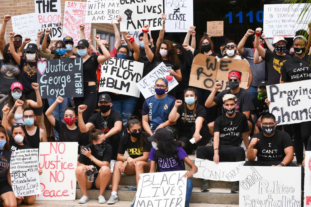 Protestors gather outside Laredo's City Hall to voice the need for social reform, Saturday, May 30, 2020, as they join nation wide protests that resulted from the death of George Floyd.