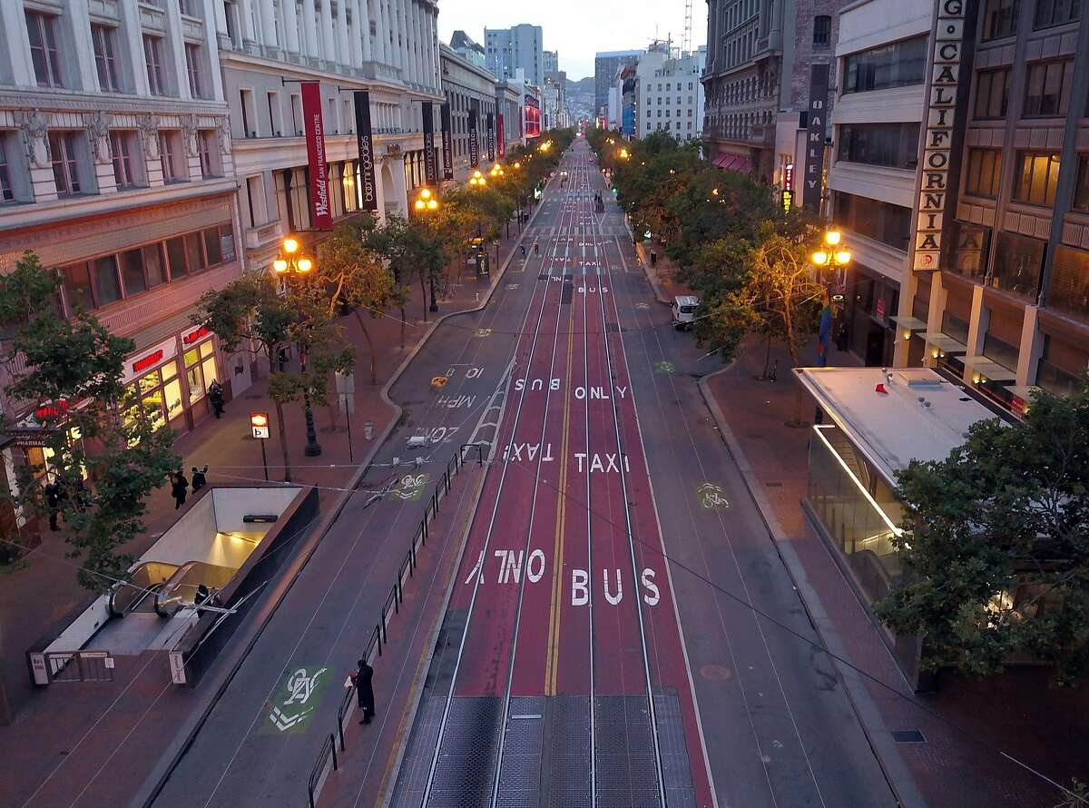 A very quiet Market Street as curfew takes hold in San Francisco, Calif., on Sunday, May 31, 2020. Mayor London Breed issued a curfew following several nights of violent protests and looting in the city.