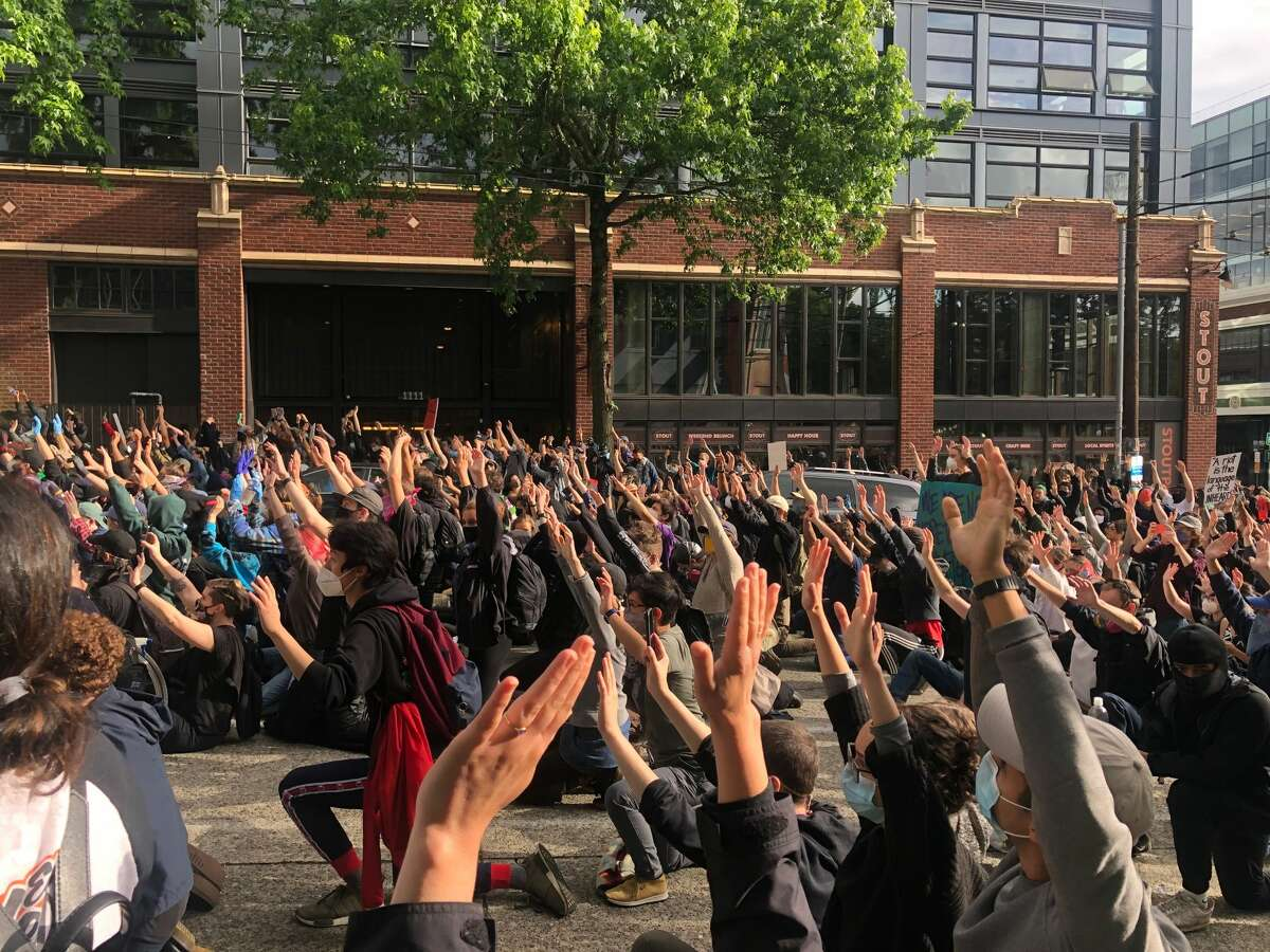 Hundreds of people on May 31, 2020 protest in Seattle after the death of George Floyd.