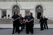San Antonio Police prepare clear a radius around Alamo Plaza in anticipation of possible riots, Sunday, May 31, 2020. A group of persons rioted last night after a peaceful rally held for George Floyd, an African-American that died when he was being arrested in Minneapolis.