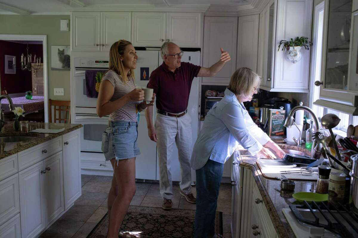 Blake Stelle, left, moved in with her parents Bruce, center, and Barbara Stelle, right, in New Hampshire.