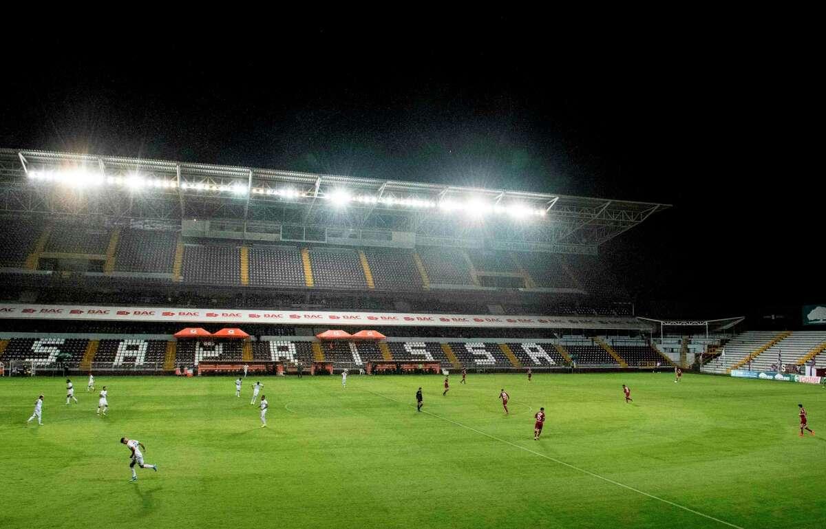 Limon FC plays against Deportivo Saprissa in an empty stadium during their Costa Rican Primera Division match at Ricardo Saprissa stadium in San Jose, Costa Rica.