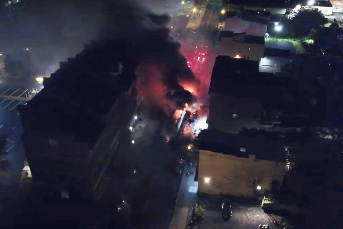 A drone captures the scene as firefighters put out blazes lit during riots in downtown Albany. (Footage by Red Shamrock Productions)
