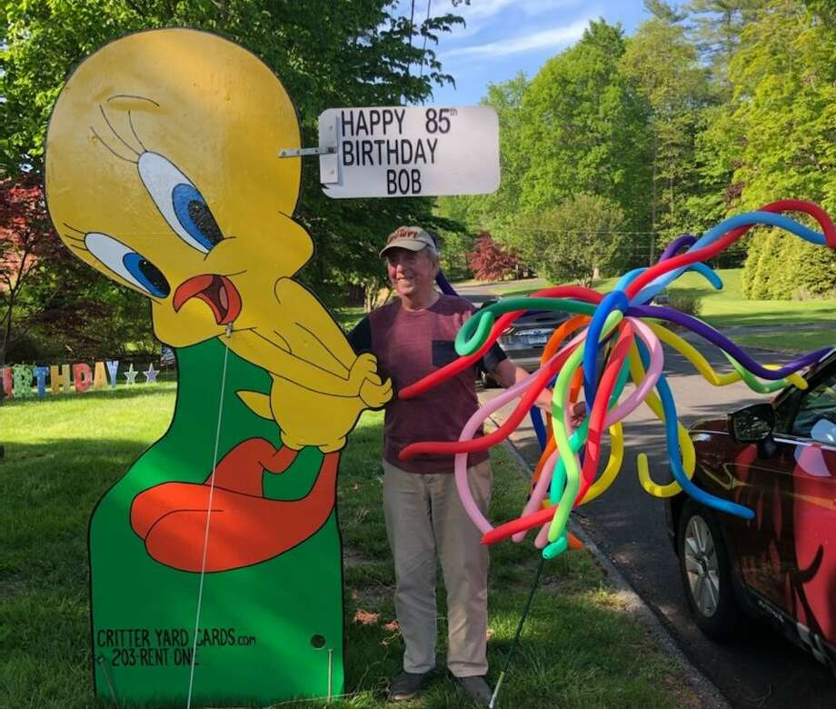 Social distancing rules did not stop dozens of friends and family from driving by Bob Lally's Brownson Road home on May 24, honking car horns and hollering Happy Birthday. Photo: Contributed Photo / Connecticut Post