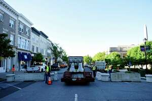 Construction crews block off the Greenwich Avenue from Arch Street to Railroad Avenue in Greenwich, Conn. Monday, June 1, 2020. Monday began Phase 1 of closing Greenwich Avenue to vehicluar traffic as a means of providing more outdoor dining space to the 17 restaurants located within that stretch.