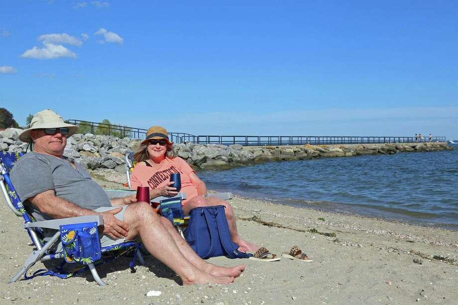 Dave and Marashane Hughes of Fairfield relax in the sun near the Fairfield Fishing Pier on Saturday, May 30, 2020, in Fairfield, Conn. Photo: Jarret Liotta / Jarret Liotta / ©Jarret Liotta 2020
