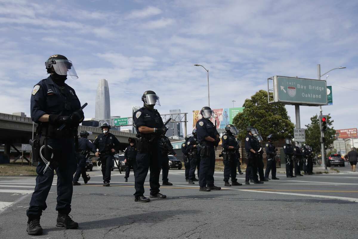 Police officers block a street near the San Francisco-Oakland Bay Bridge in San Francisco, Sunday, May 31, 2020, at a protest over the Memorial Day death of George Floyd. Floyd was a black man who was killed in police custody in Minneapolis on May 25.