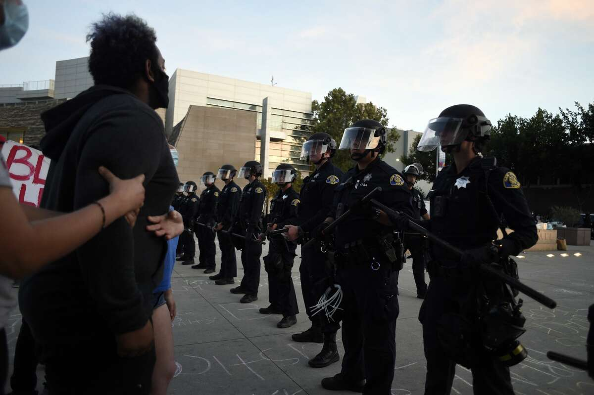 Police take security measures as a small group of protestors showed up at the San Jose City Hall, site of Friday nights demonstration turned riot following the death of George Floyd in Minneapolis on May 30, 2020 in California, United States.