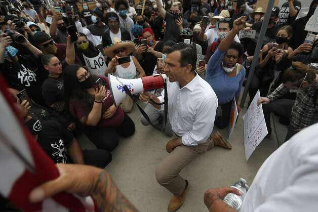 How can I help? A petition demanding justice for Floyd has over 12 million signatures and is the biggest Change.org petition of all time. Several media outlets have created list of ways to help including the Courier, USA Today, Oprah Magazine and The Cut. In the photo above, San Jose Mayor Sam Liccardo, center, speaks to protesters as he takes a knee during a protest over the death of George Floyd outside of San Jose City Hall in downtown San Jose, Calif., on May 31, 2020. Amy Graff is a digital editor and Katie Dowd is a senior digital editor at SFGATE. Photo: Nhat V. Meyer/Associated Press / Bay Area News Group