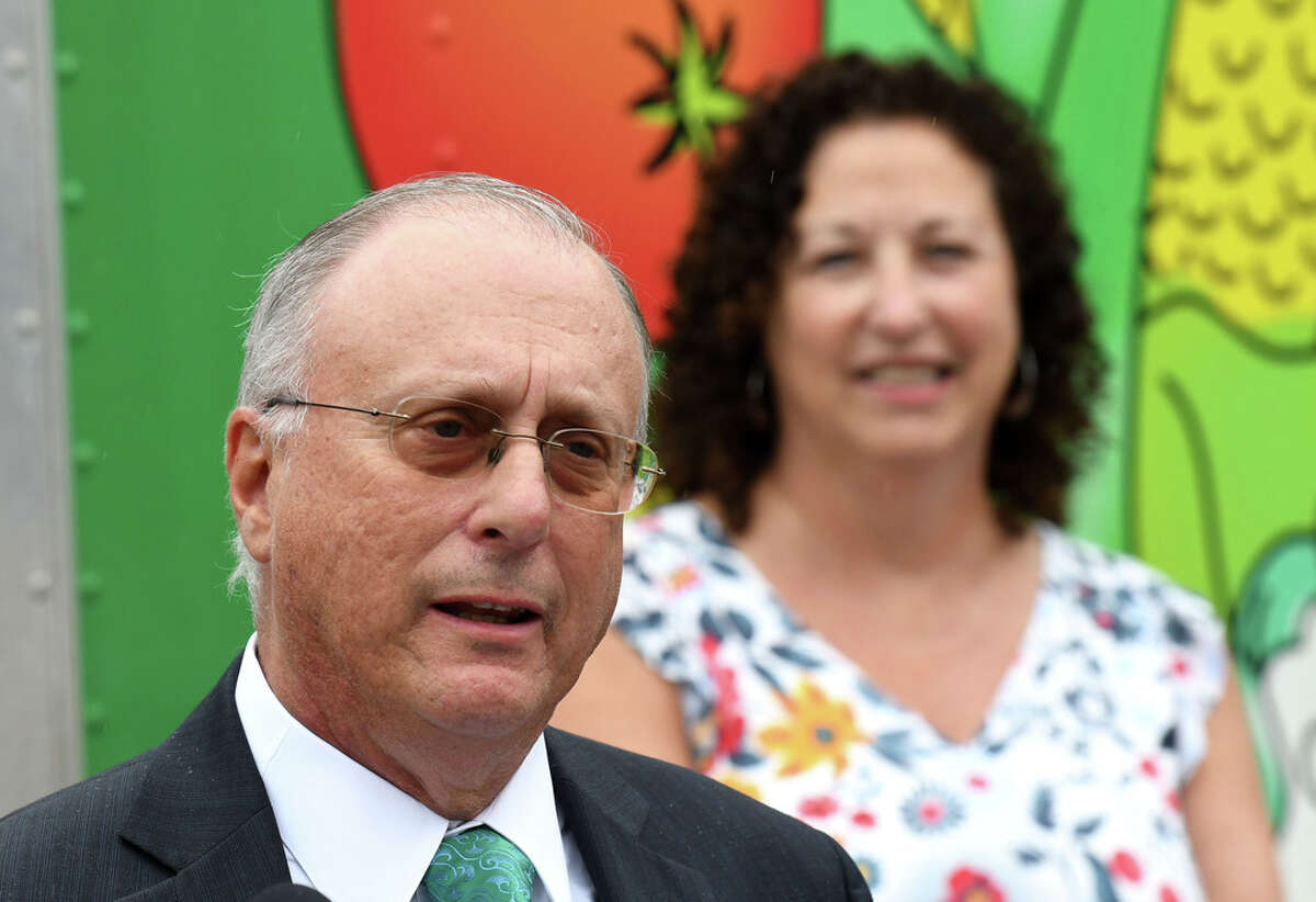 CDPHP CEO Dr. John D. Bennett speaks during an unveiling of Capital Roots' new Veggie Mobile on Tuesday, Aug. 13, 2019, in Troy, N.Y. The truck is used to provide fresh produce to inner-city neighborhoods throughout the Capital Region. CDPHP sponsors the program. (Will Waldron/Times Union)