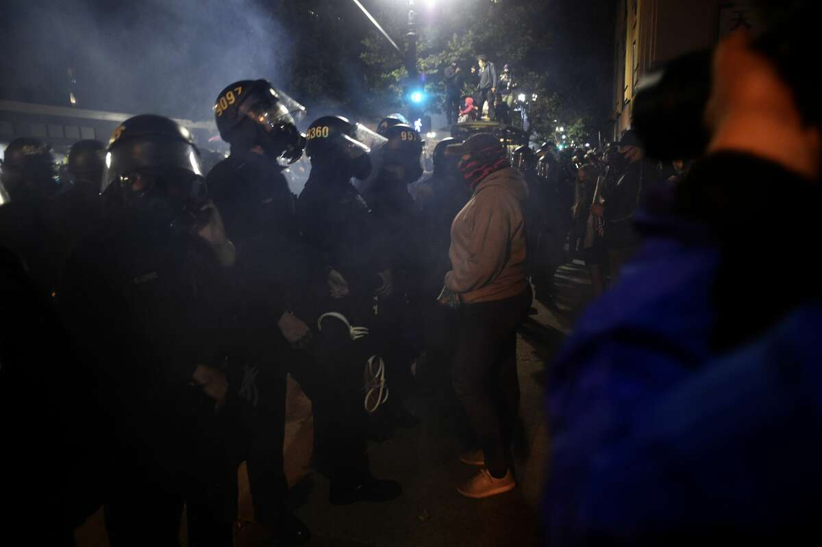 Police face off against protesters demonstrating the killing of George Floyd in Downtown Oakland, May 29th 2020.