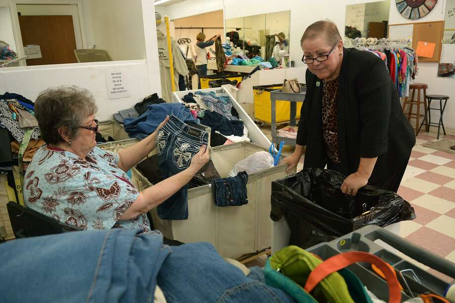 Cypress Assistance Ministries Executive Director Martha Burnes, right, chats with Sandy Kahler as Kahler sorts clothes items in the cellar of the Angels' Attic resale shop on Oct. 22, 2015. (Photo by Jerry Baker/Freelance)4 Photo: Jerry Baker, Freelance / For The Houston Chronicle