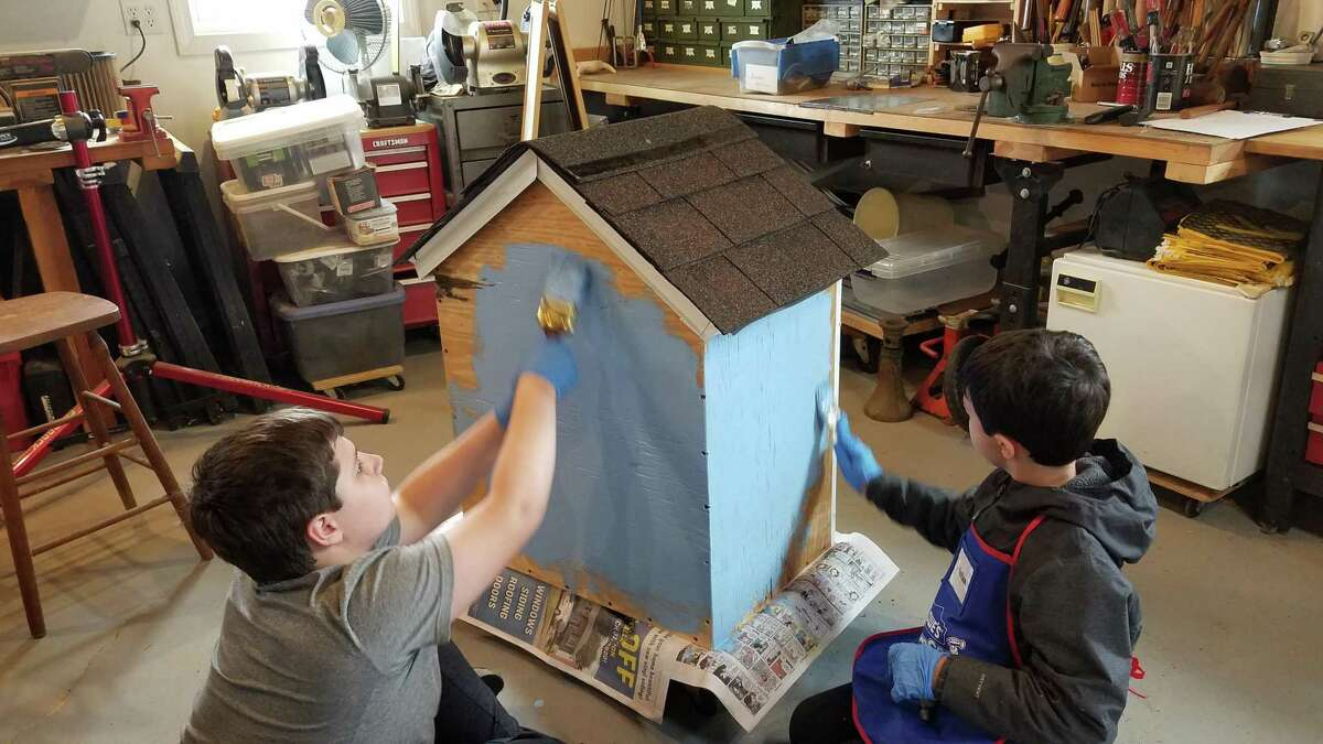 Julian and Tristan working on the Little Library in the workshop.
