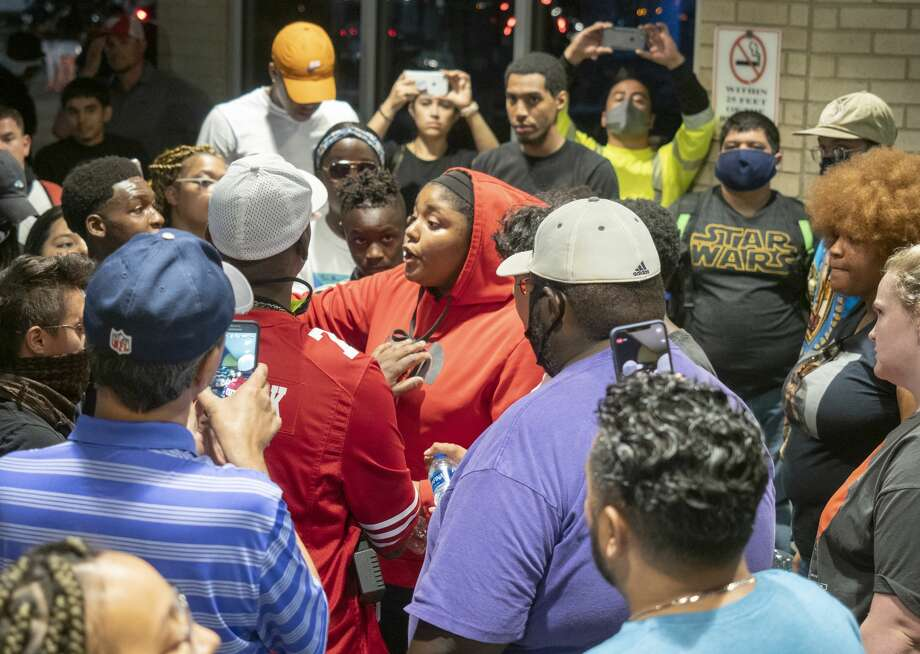 When Midland police pulled their members back and inside the mall, protesters followed 05/31/2020 night to continue their protest. Courtney Ratliff is seen in wearing a purple shirt and tan baseball hat. Photo: Tim Fischer/Midland Reporter-Telegram