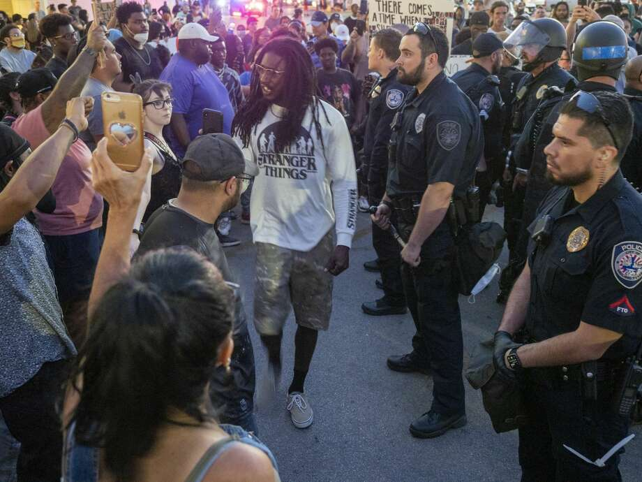 As the night went on different activists offered words of encouragement 05/31/2020 to the crowd gathered outside Midland Park Mall. Jaime Moreno is seen in the foreground wearing a black shirt and black hat. Photo: Tim Fischer/Midland Reporter-Telegram