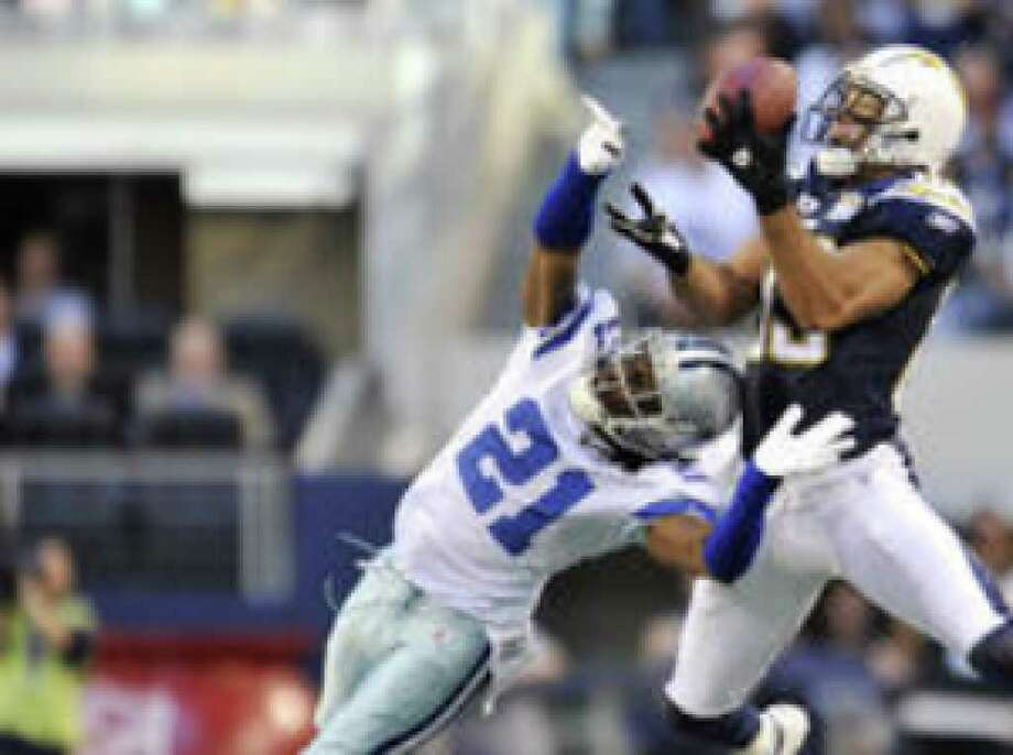 San Diego Chargers wide receiver Vincent Jackson (right) hauls in a pass over Dallas Cowboys cornerback Mike Jenkins. Jackson made seven catches for 120 yards Sunday as the Chargers beat the Cowboys 20-17 in Arlington.
