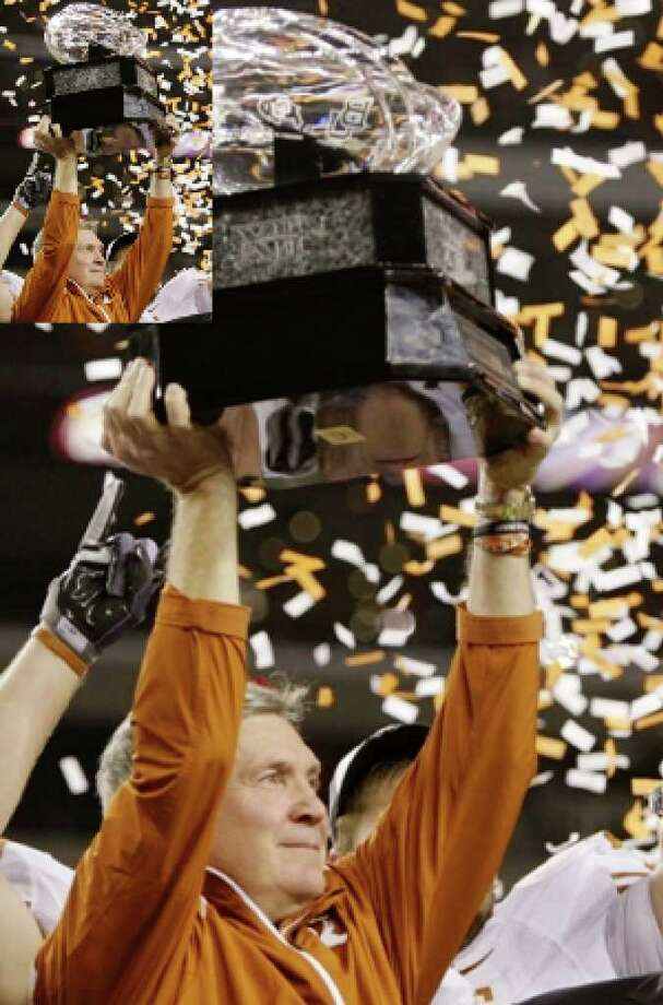 Head coach Mack Brown of the Texas Longhorns lifts the trophy after his team's victory over the Nebraska Cornhuskers in the game at Cowboys Stadium on December 5 in Arlington.