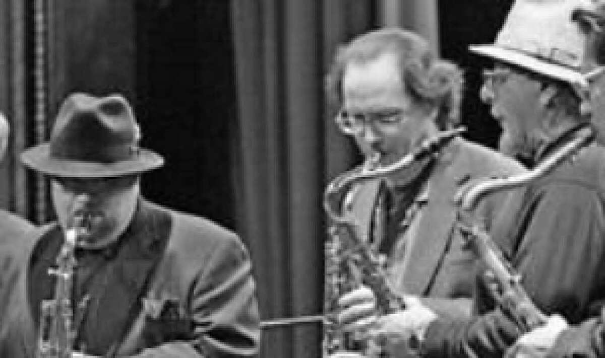Richard Garcia (from left), Richard Oppenheim, John Magaldi and Frank Rodarte were part of last year's Holiday Saxophones concert and are expected back this year.