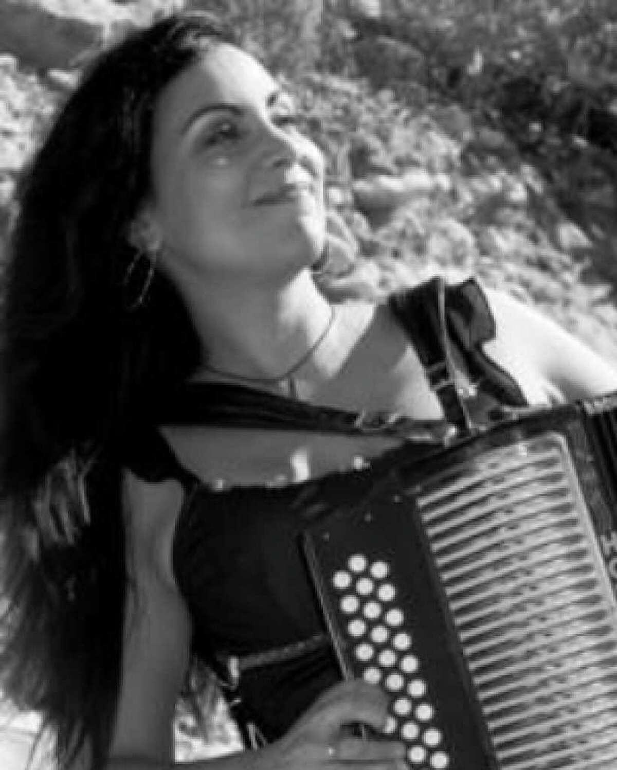 Accordionist Tara Linda plays Casbeers at the Church Friday.