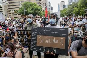 People gather by the thousands in protest against the Austin Police Department and the deaths of George Floyd and Michael Ramos in Austin on Sunday, May 31, 2020. [BRONTE WITTPENN/AMERICAN-STATESMAN]