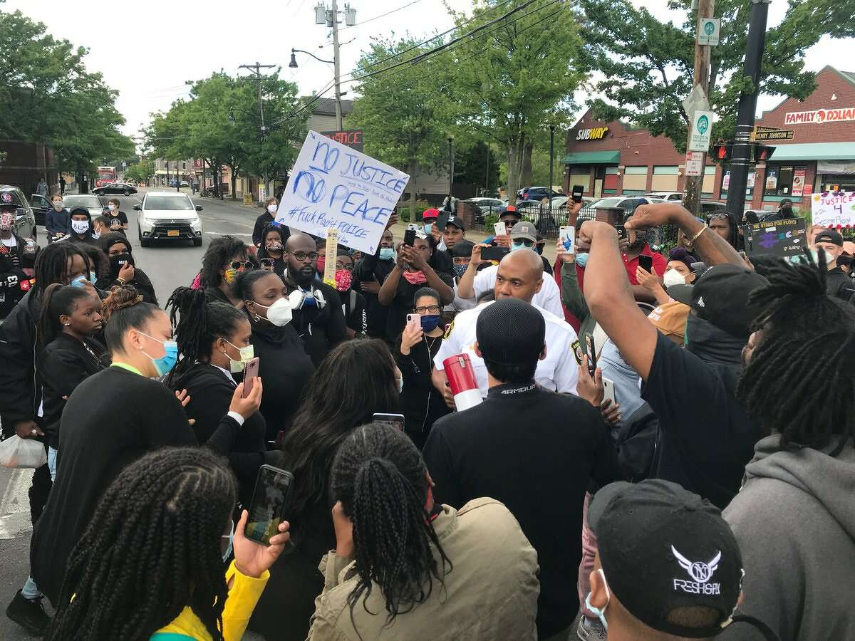 Albany Police Chief Eric Hawkins speak with protesters Monday Henry Johnson Boulevard and Livingston Avenue in Albany.