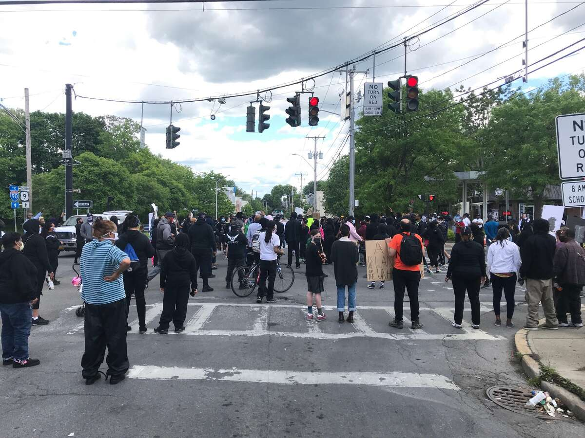 Protesters marching against police brutality close Henry Johnson Boulevard and Livingston Avenue in Albany on Monday.
