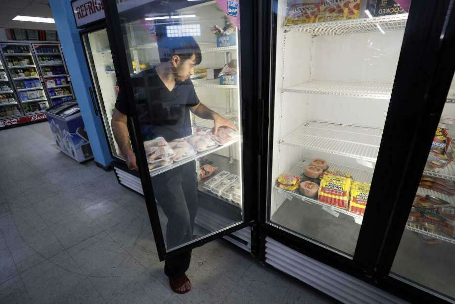 Hardik Kalra stocks meat in a cooler at a local super market, Friday, May 29, 2020, in Des Moines, Iowa. Photo: Charlie Neibergall, AP