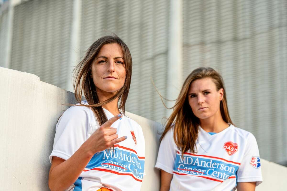 Houston Dash midfielder Haley Hanson and forward Veronica Latsko in the team's new alternate uniforms, which pay tribute to the Houston Oilers.