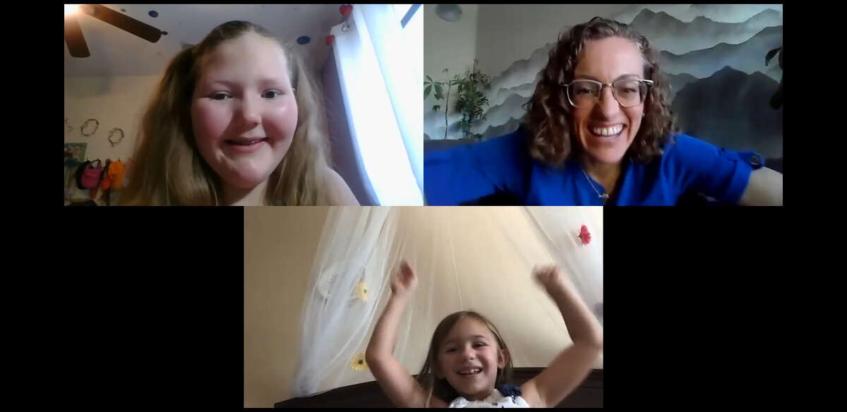 Sarah Rose Braithwaite, 13, top left, program director Katie Frazee and Molly Marks, 7, during their recent virtual meeting.