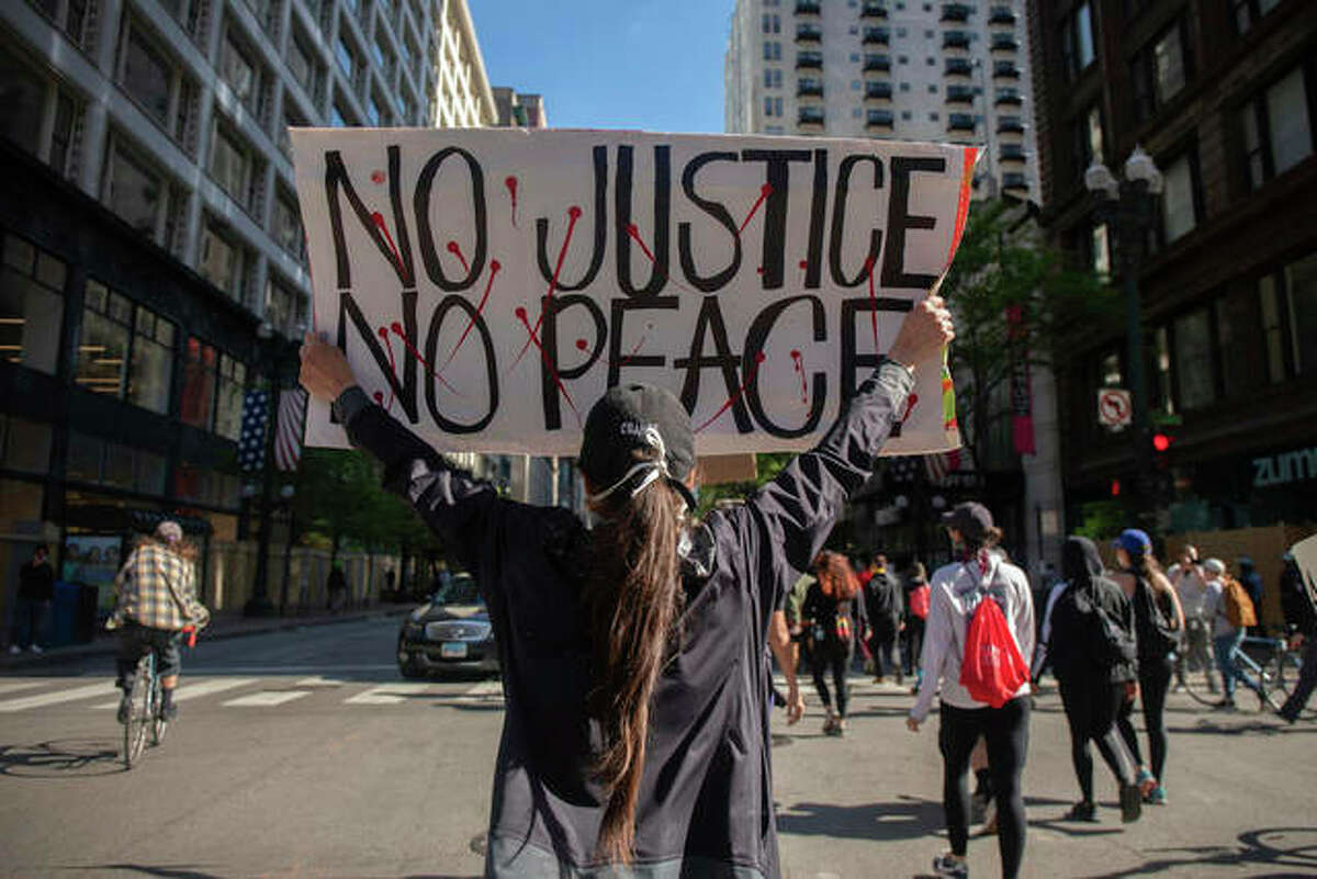 Protesters gather from Daley Plaza in Chicago to protest George Floyd's death. Floyd died after being restrained by Minneapolis police officers on May 25. Pat Nabong | Chicago Sun-Times (AP)