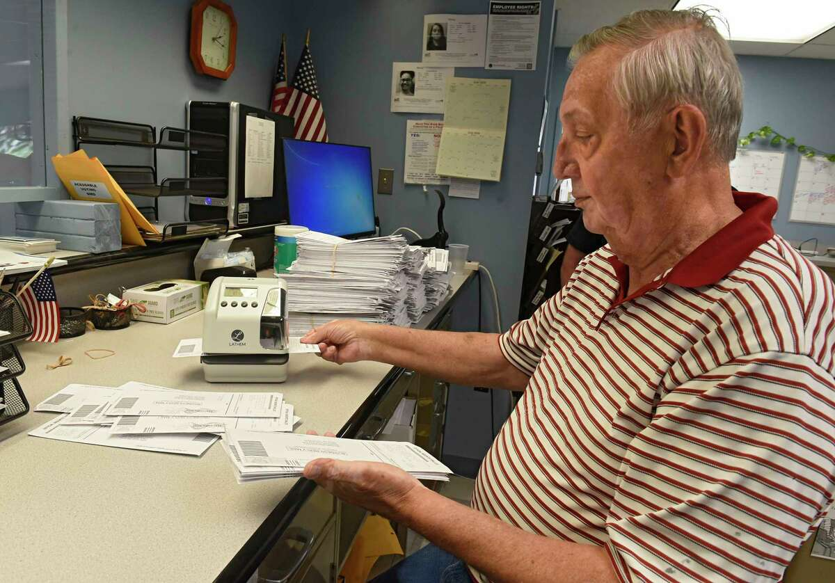 Custodian of Records Raymond Frankwski stamps the date and time on absentee ballots as Rensselaer County Board of Elections handles thousands of absentee ballots for June 23 primary on Monday, June 1, 2020 in Troy, N.Y. (Lori Van Buren/Times Union)