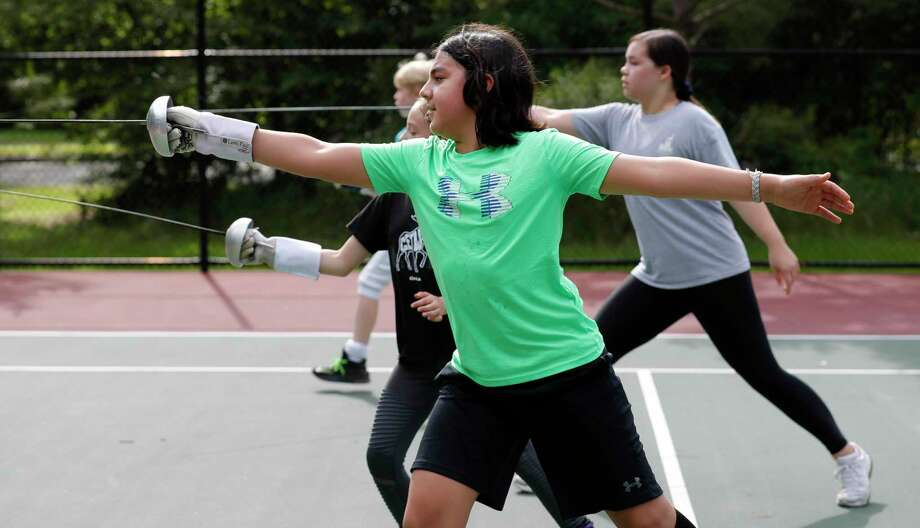 Chase Gomez works on his lunging as students with the Alliance Fencing Academy practice at Falconwing Park, Saturday, May 2, 2020, in The Woodlands. Photo: Jason Fochtman, Houston Chronicle / Staff Photographer / 2020 © Houston Chronicle