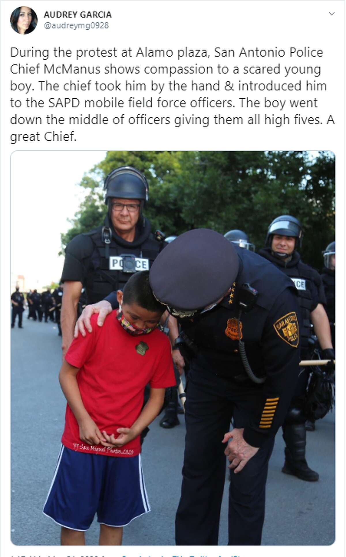 San Antonio Police Chief William McManus comforted a young boy who was at the protests on Saturday.