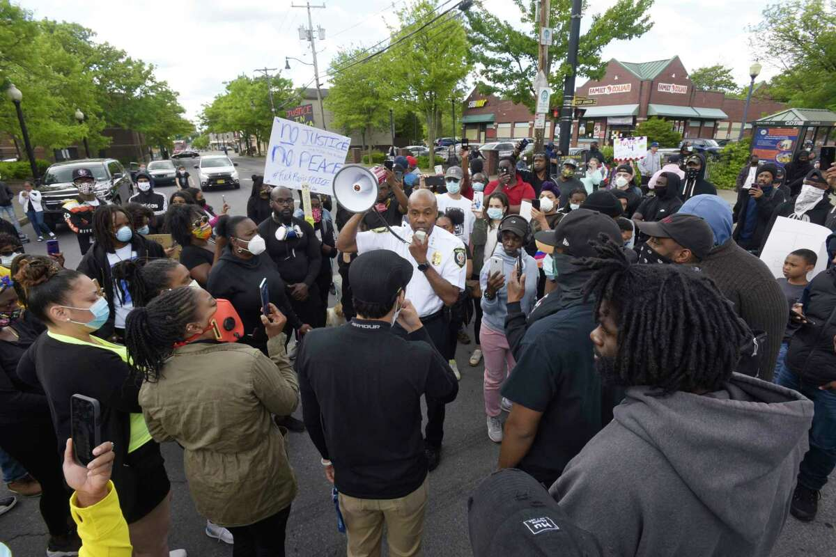 Albany Police Chief Eric Hawkins talks to protestors who had gathered in the street at the intersection of Henry Johnson Blvd. and Livingston Ave. on Monday, June 1, 2020, in Albany, N.Y. (Paul Buckowski/Times Union)