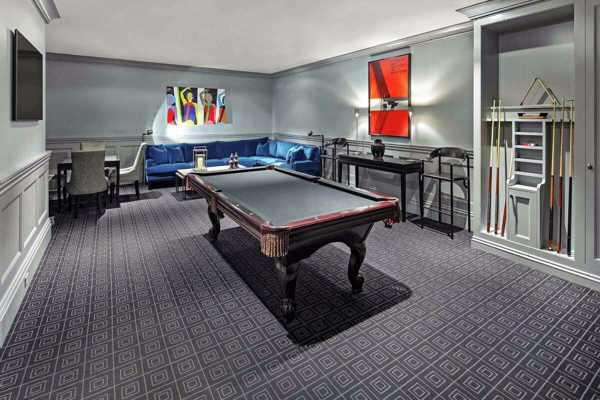 The lower level features a billiard room with wall-to-wall carpeting.