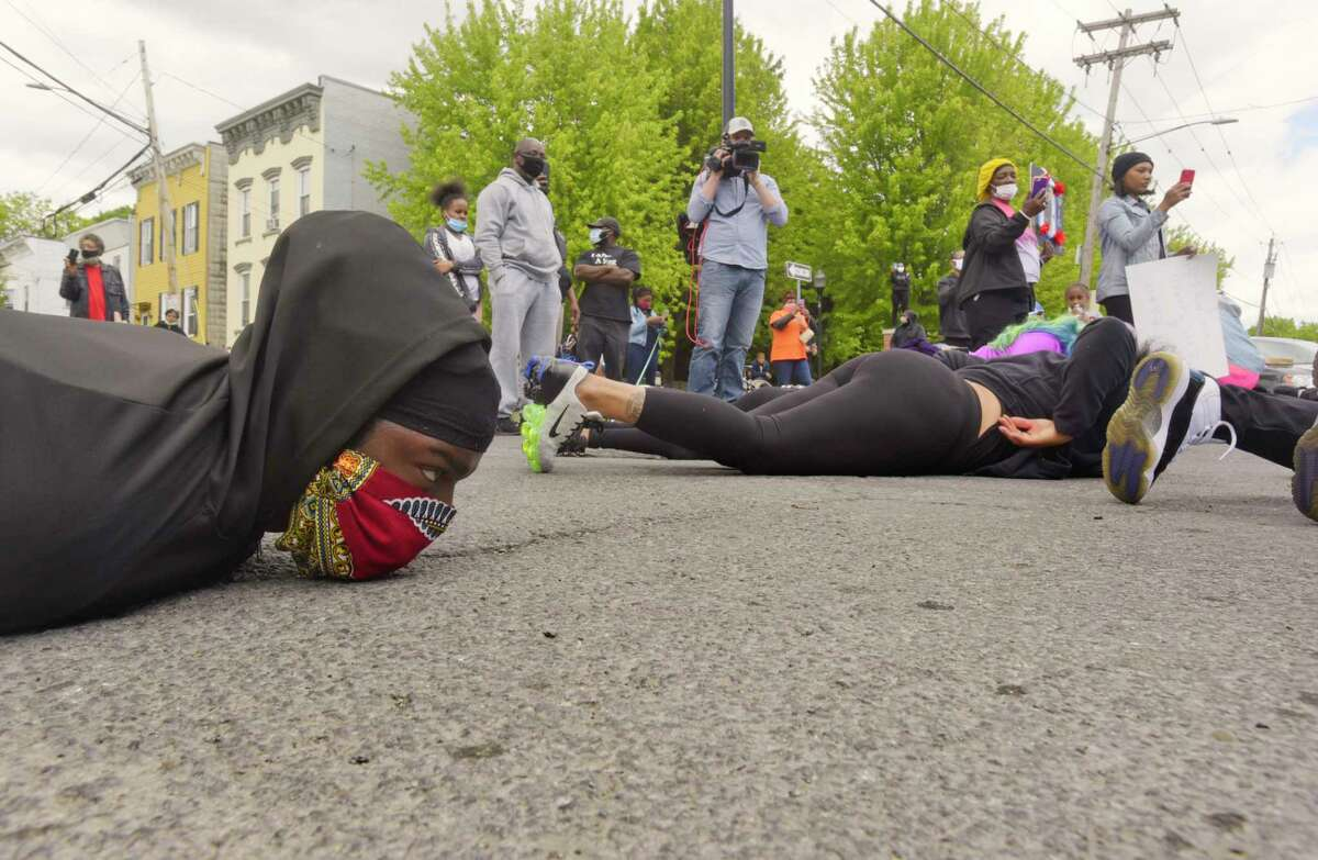 Protesters gathered in the street at the intersection of Henry Johnson Blvd. and Livingston Ave. lay down with their hands behind their backs for nine minutes on Monday, June 1, 2020, in Albany, N.Y. George Floyd, who died while in police custody in Minneapolis, MN, was face down on the ground with an officers knee on his neck for nine minutes. (Paul Buckowski/Times Union)