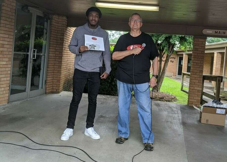 Conroe Jazz Connection Director Bob Price, right, presented a Jazz Connection Scholarship to Tyrese Bell who is graduating from Conroe High School. Bell is the lead tenor saxophone player for the Jazz Connection. Photo: Photo Courtesy Lauri McGuyer