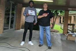 Conroe Jazz Connection Director Bob Price, right, presented a Jazz Connection Scholarship to Tyrese Bell who is graduating from Conroe High School. Bell is the lead tenor saxophone player for the Jazz Connection.