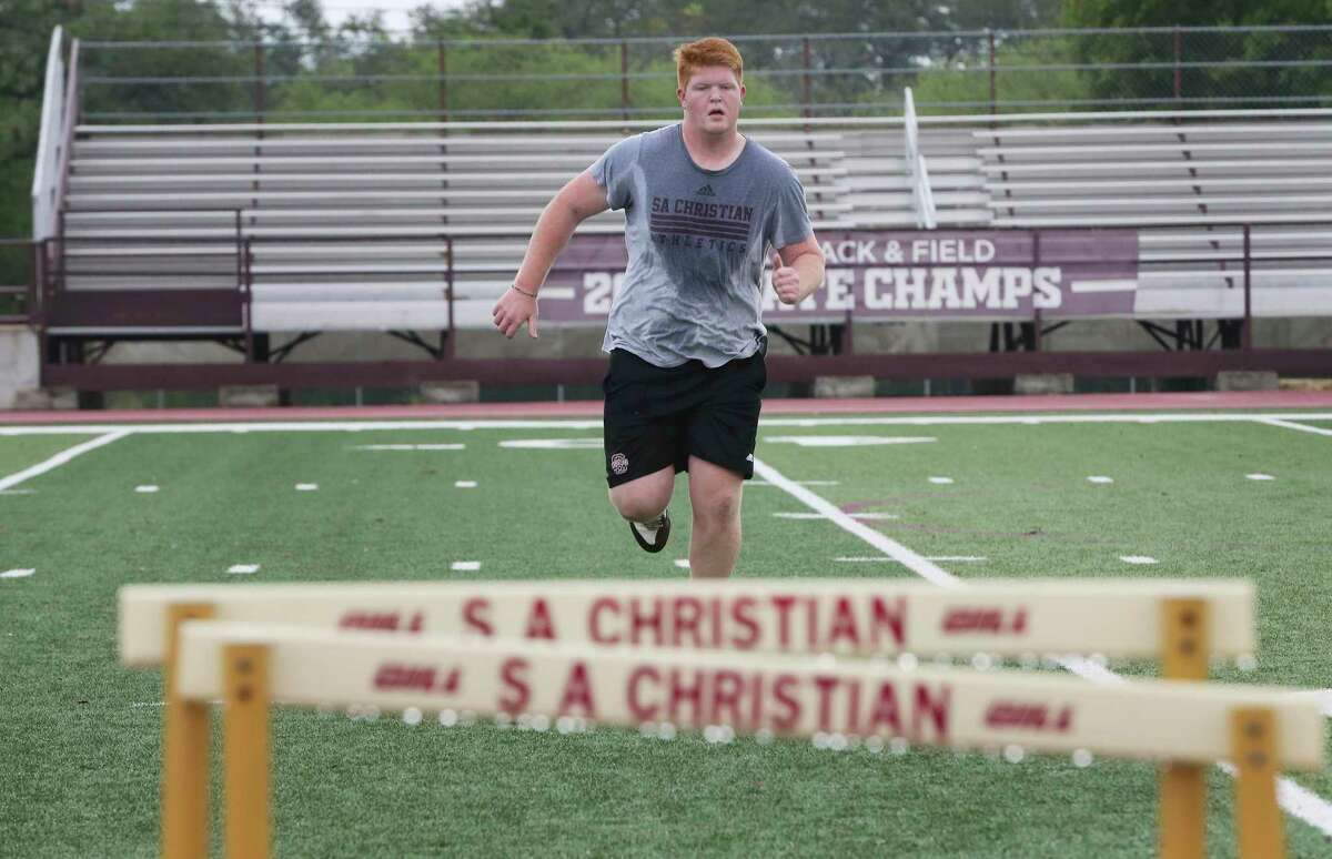 Varsity Football standout Ethan Sanders participates in running drills as about 30 members of the San Antonio Christian Schools football team participate in summer conditioning camps on Monday, June 1, 2020. TAPPS allowed schools to begin these camps as early as June 1. The session lasted one hour. These camps could be the first step to normalcy since the coronavirus pandemic shut down sports for most of the spring season. It's the first time school coaches are getting a chance to work with their kids since the shutdown.