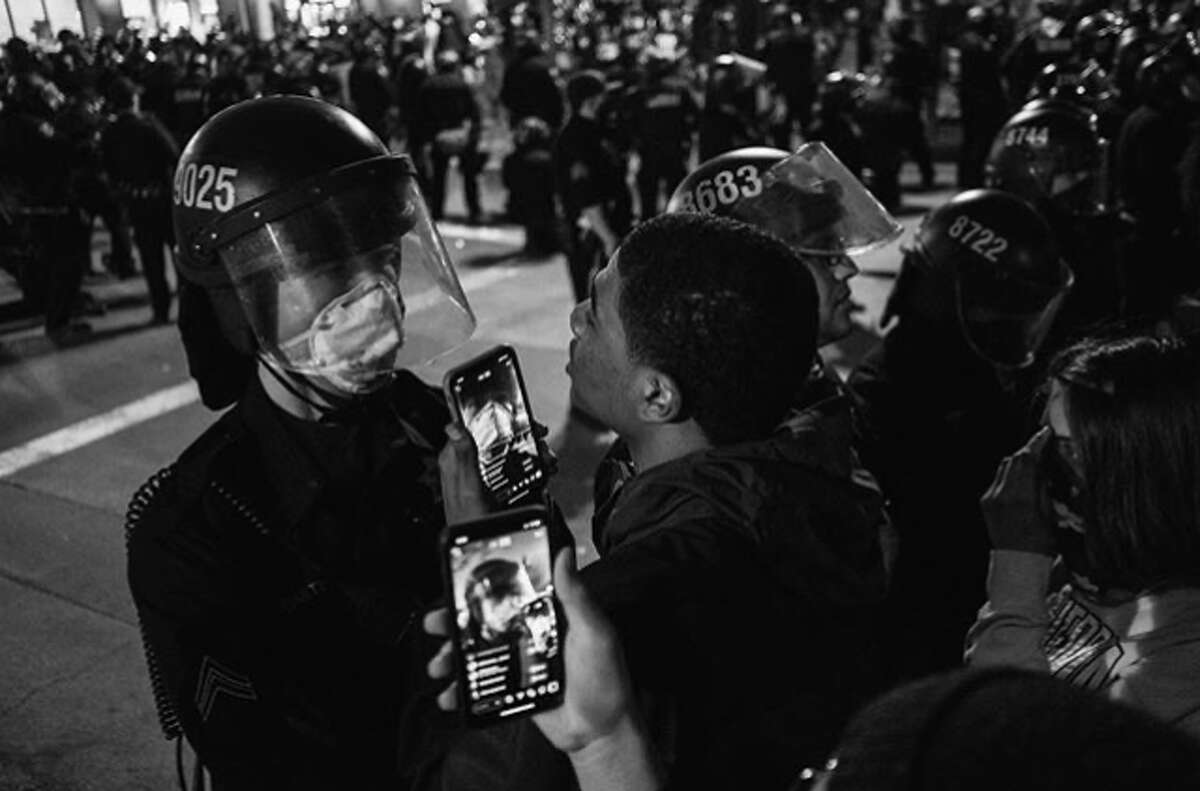 Protesters and police officers face off in Oakland in protest against the death of George Floyd. (Brandon Ruff / @ruffdraft)