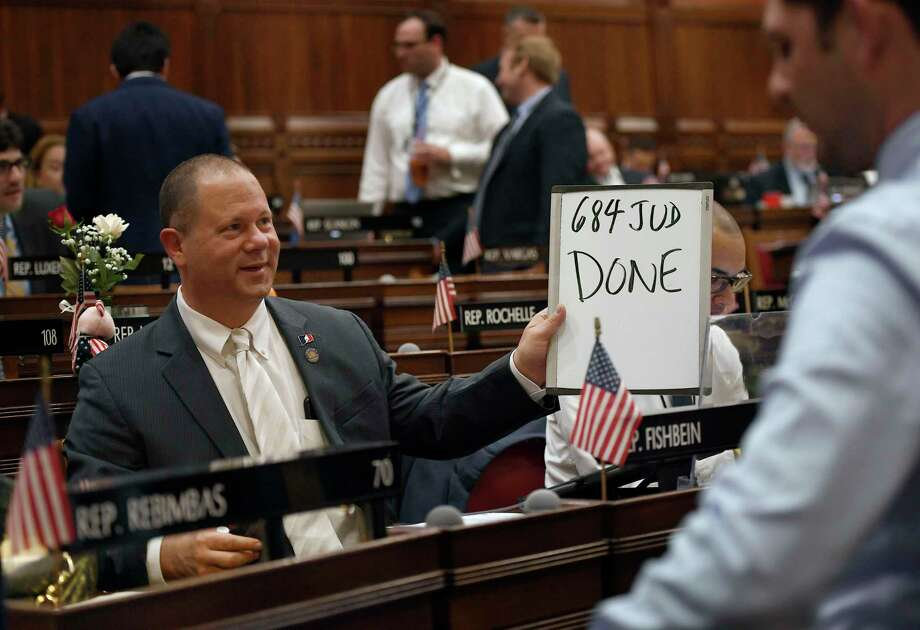 State Rep. Craig Fishbein, R-Wallingford, holds up a sign after a vote during the final day of session at the State Capitol in Hartford, Conn., Wednesday June 5, 2019. (AP Photo/Jessica Hill) Photo: Jessica Hill / Associated Press / Copyright 2019 The Associated Press. All rights reserved
